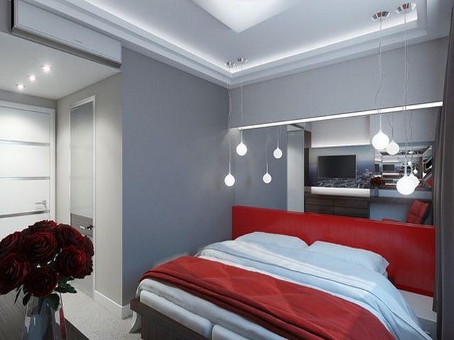 серые обои и яркий текстиль в спальне